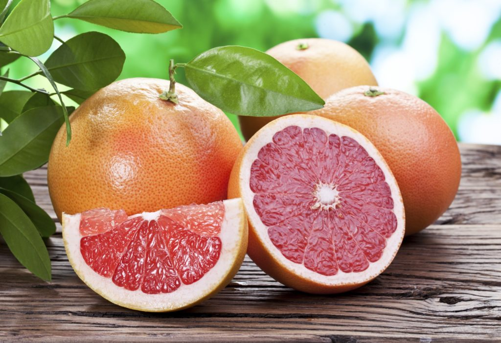 Grapefruits on a wooden table.
